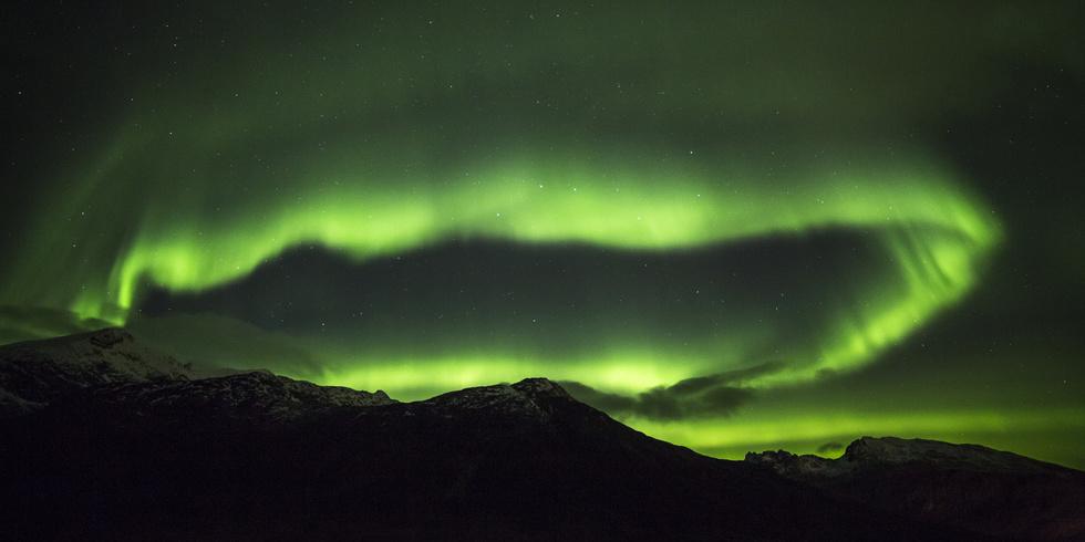 Polarlichter (Aurora borealis) in der Region Troms, Norwegen